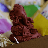 Relaxing Baby Ganesha with Natural Gulal (Holi color) - Holi Gift combo