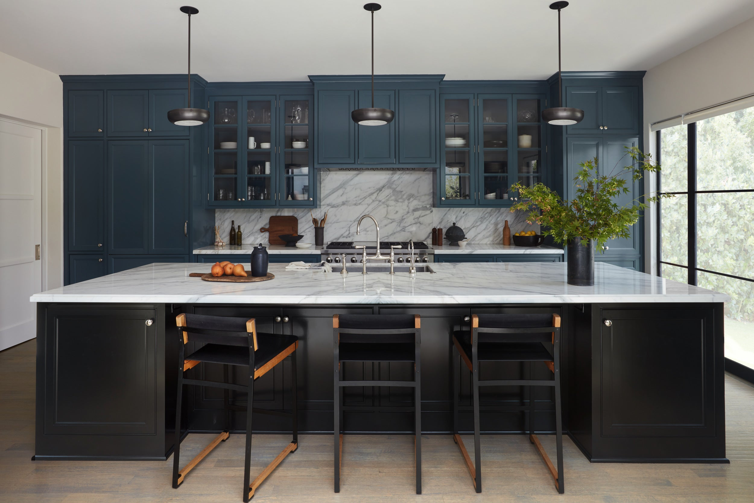 Studio Lifestyle's Westwood Project kitchen features RTO Lighting's small Lucille selenite pendant in oil rubbed bronze & brass.