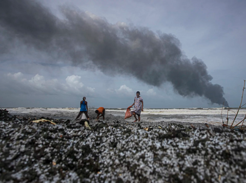 Sri Lankans salvage wreckage washed from the burning Singaporean ship X-Press Pearl last week.