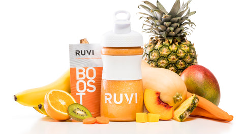 Ruvi Boost fruit and veggie smoothie surrounded by tropical fruits