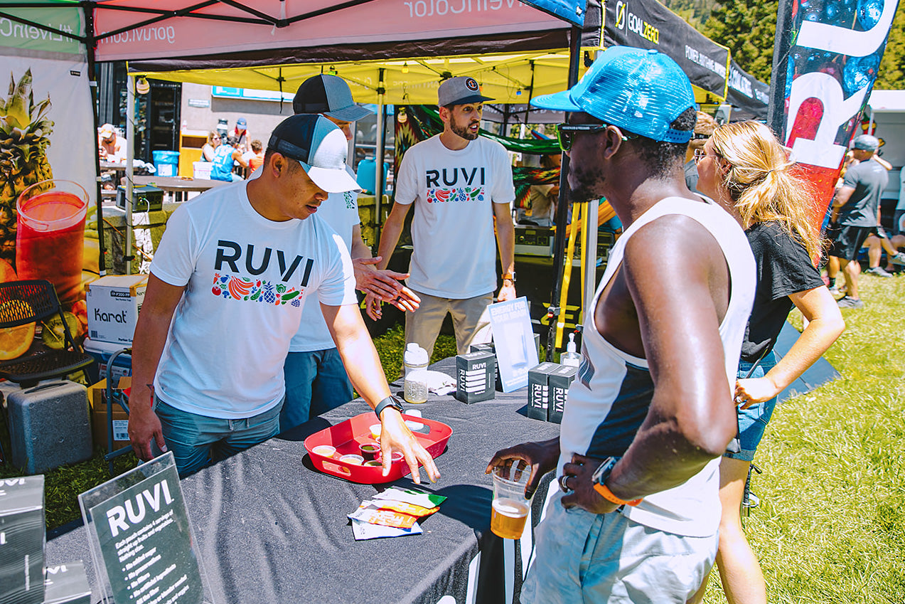 Ruvi Team at Cirque Series 2021 talking to people about Ruvi smoothies and giving samples at their vendor booth