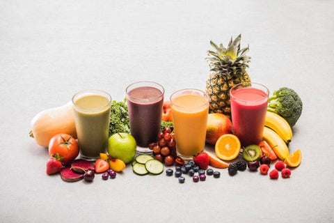 Ruvi smoothies surrounded by 26 different fruits and vegetables