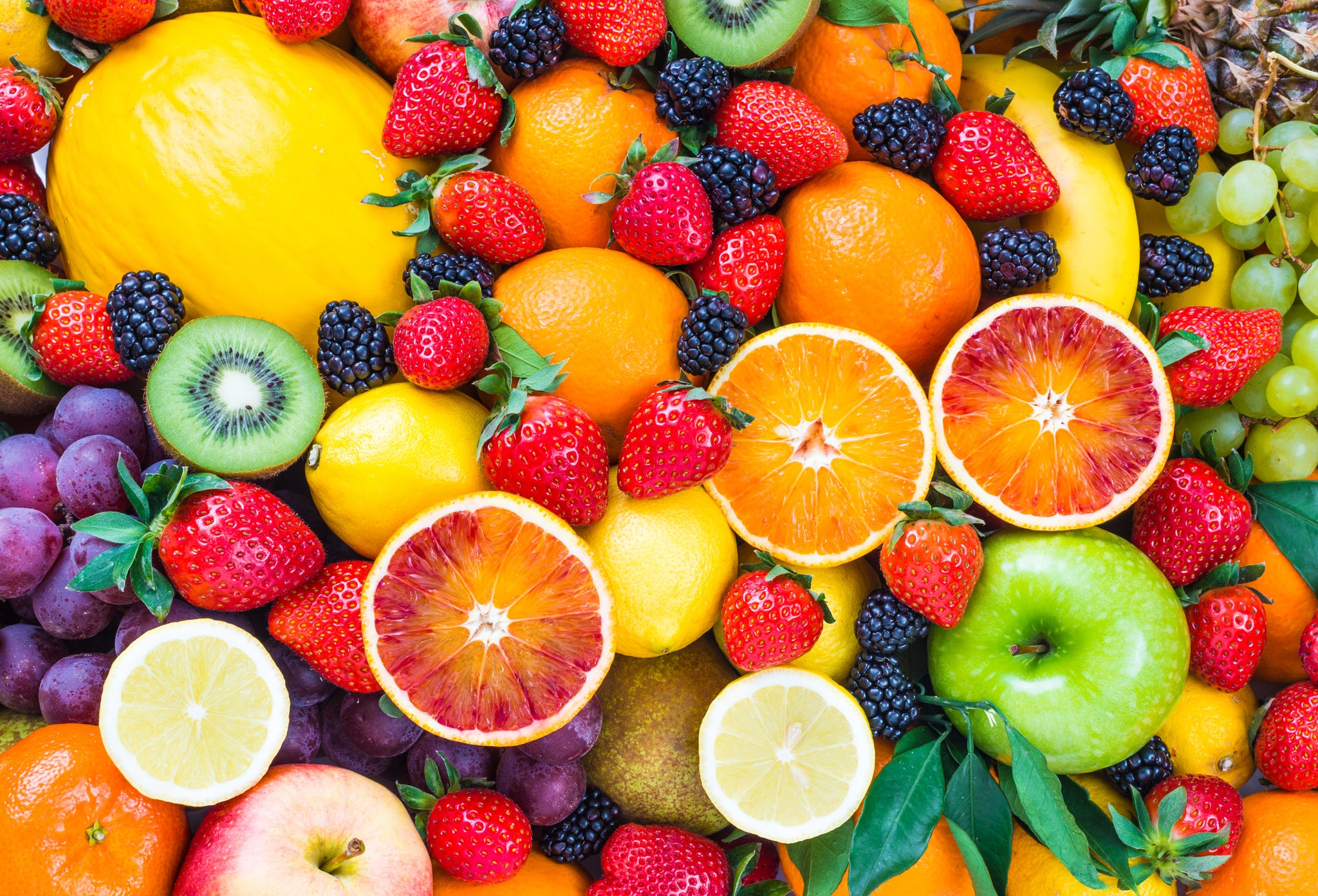 bright and colorful fruits and veggies in a pile
