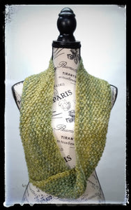 """Meadow"" Hand Knit Twisted Infinity Scarf was created with Berroco Air blown bulky weight yarn in Geothermal colorway, worn long."
