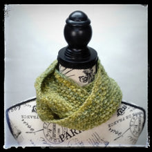 "Load image into Gallery viewer, ""Meadow"" Hand Knit Twisted Infinity Scarf was created with Berroco Air blown bulky weight yarn in Geothermal colorway, worn wrapped."