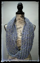 "Load image into Gallery viewer, ""Spring's Promise"" Hand Knit Twisted Infinity Scarf was created with Loops & Threads Country Loom soft and cozy Super Bulky acrylic yarn in Lavender Blues colorway, worn long."
