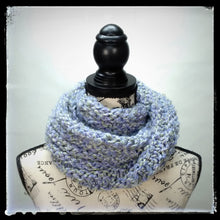 "Load image into Gallery viewer, ""Spring's Promise"" Hand Knit Twisted Infinity Scarf was created with Loops & Threads Country Loom soft and cozy Super Bulky acrylic yarn in Lavender Blues colorway, worn wrapped."