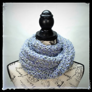 """Spring's Promise"" Hand Knit Twisted Infinity Scarf was created with Loops & Threads Country Loom soft and cozy Super Bulky acrylic yarn in Lavender Blues colorway, worn wrapped."