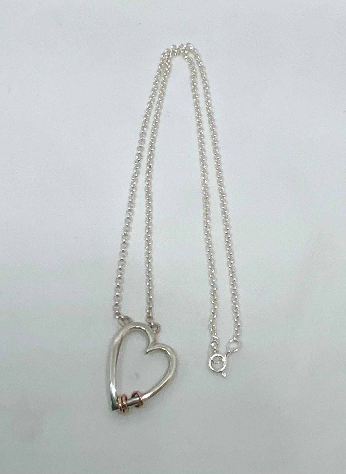 Sterling Silver Heart Necklace with Gold Rings handmade by James