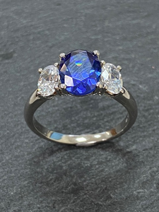 BLUE AND WHITE 3 STONE CUBIC ZICONIA RING