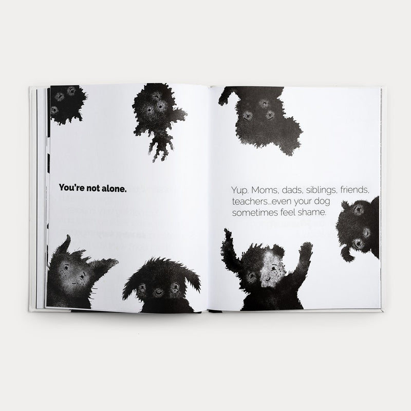"A Spread of A Kids Book About Shame. It says ""You're not alone."""