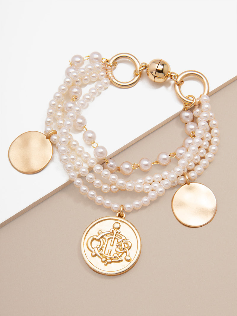 Effortless Elegance Pearl and Charm Bracelet