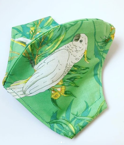 Triple layered face mask made in Melbourne Australia from cotton and poplin featuring a unique cockatoo print