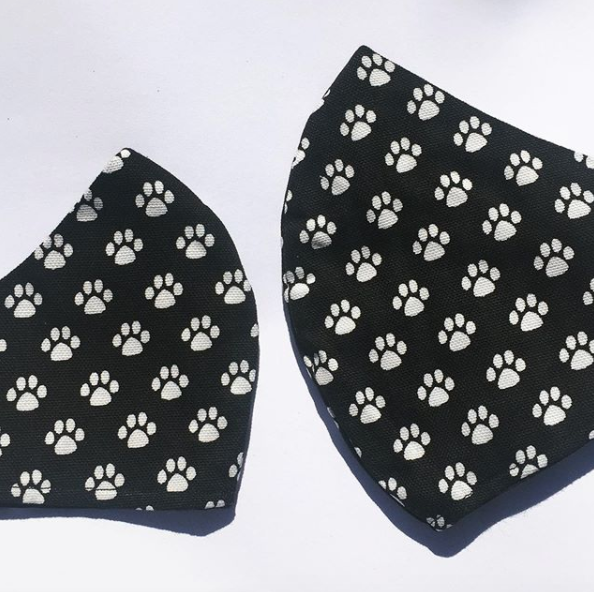 Triple layered face mask made in Melbourne Australia from cotton and poplin featuring a unique dog paw prints print