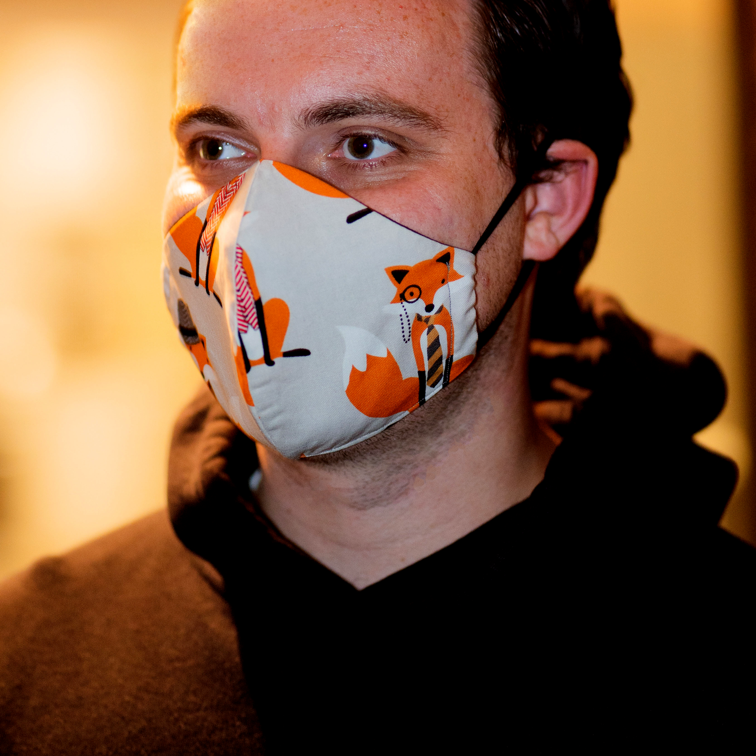 Triple layered face mask made in Melbourne Australia from cotton and poplin featuring a unique fox print. The Tailored Shapely style includes an embedded adjustable nose bridge and a hidden filter pocket.