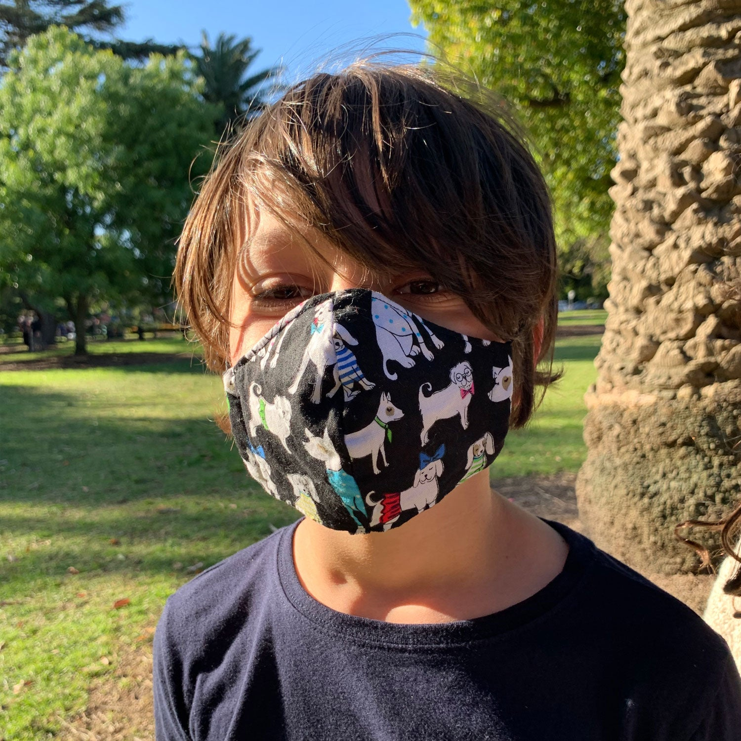 Triple layered kids face mask made in Melbourne Australia from cotton and poplin featuring a fun fox print
