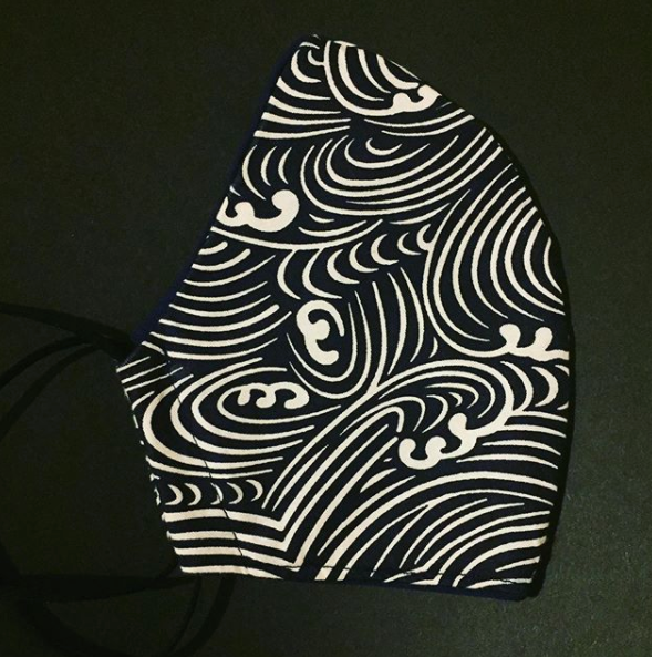 Triple layered face mask made in Melbourne Australia from cotton and poplin featuring a unique modern wave print