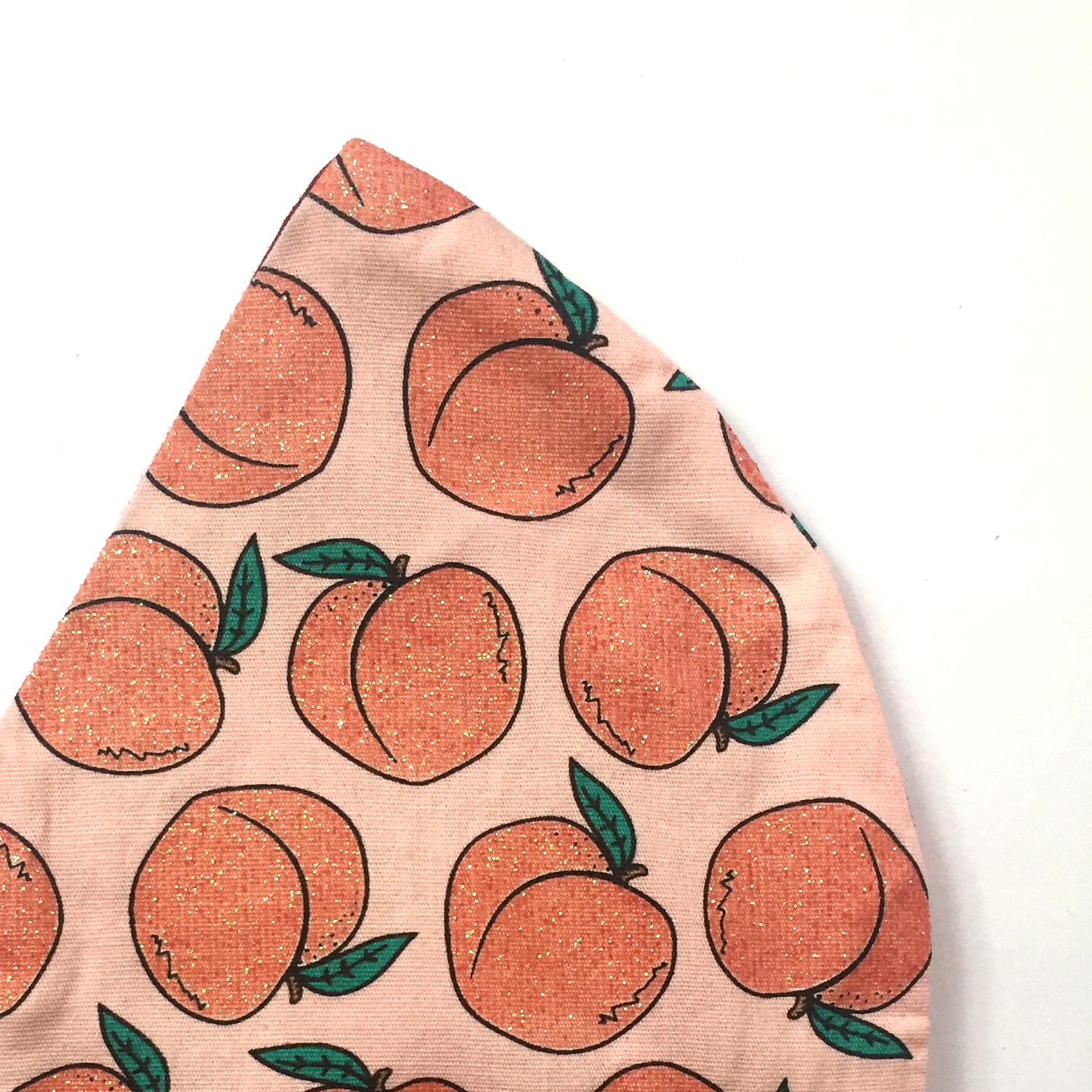 Triple layered face mask made in Melbourne Australia from cotton and poplin featuring a unique sparkly peach emoji emoticon print