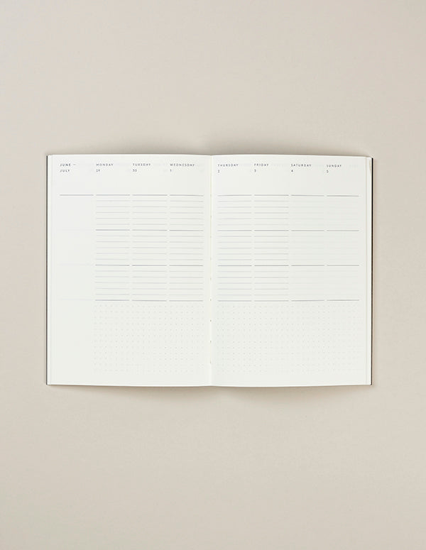 Mark+Fold's award-winning minimal diary layout, week-to-view pages with maximum writing space and no 'page clutter.' The page is divided into neat zones, but without prescriptive pointers telling you what to write where.