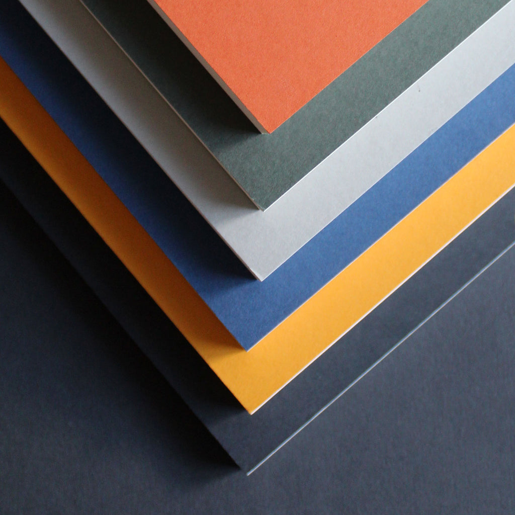 Mark+Fold layflat notebooks, lined pages rust sequoia, dpt grid pages mustard flint, plain pages cobalt lichen