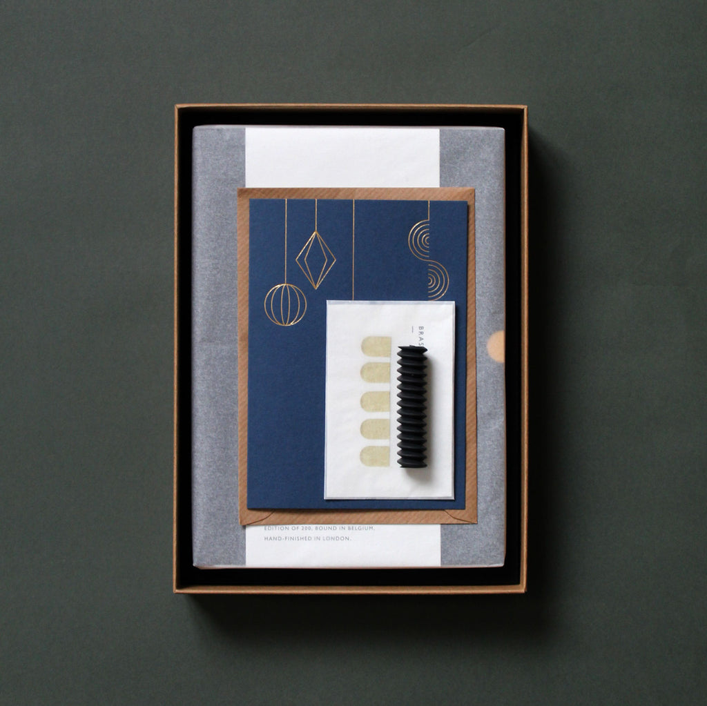 Mark+Fold Stationery Subscription parcel, including notebook / diary, brass pager markers, spiral eraser and pendant card. Gift box, stationery box, stationery subscription