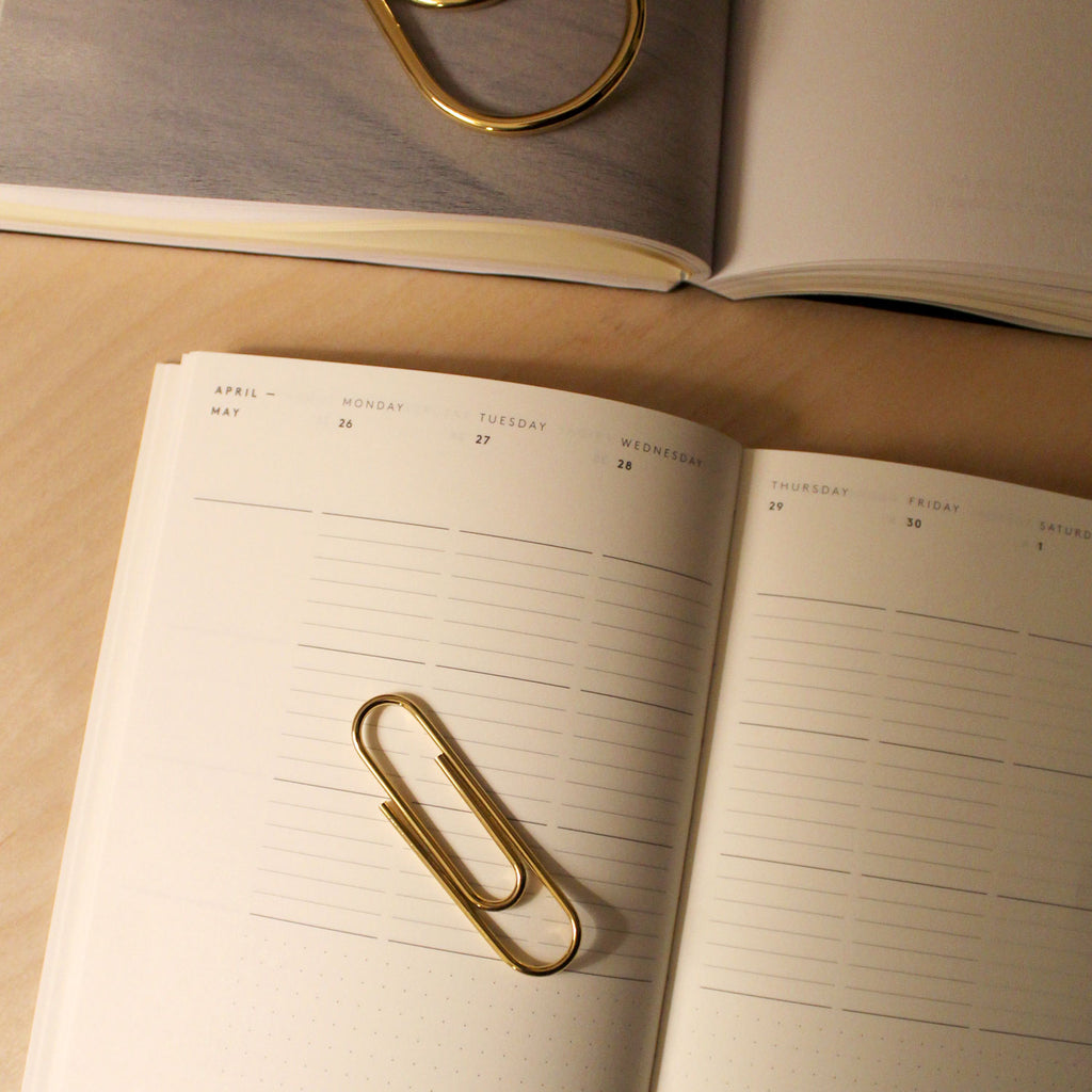 Carl Auböck Paperclip in Solid Brass, for Mark+Fold, luxury desk object, made in Vienna. With Mark+Fold 2021 Diary in mustard