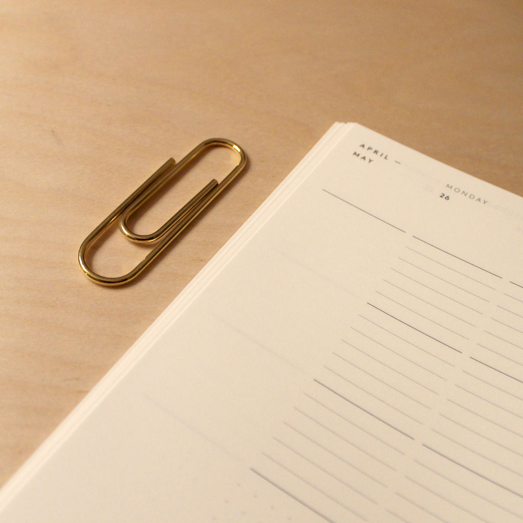 Carl Auböck Paperclip in Solid Brass, for Mark+Fold, luxury desk object, made in Vienna. With the Mark+Fold 2021 Diary minimal layflat diary eco sustainable production in Europe