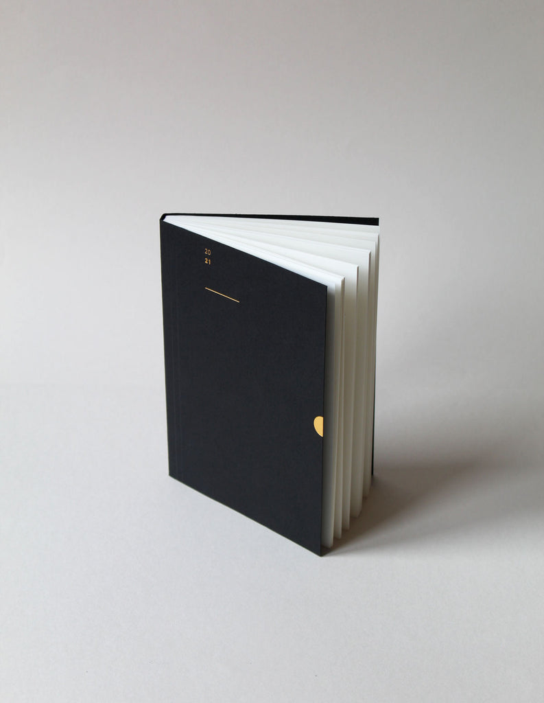 The Mark+Fold 2021 Diary in black, featuring our award-winning minimal layout