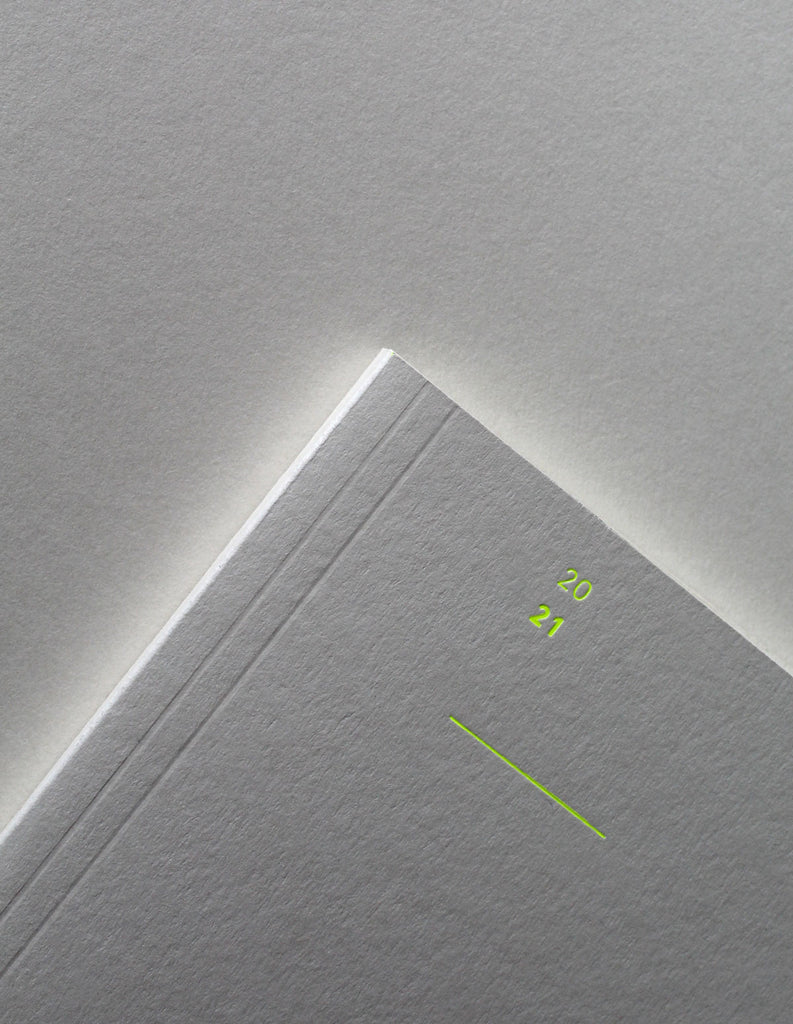 Detail of the Mark+Fold 2021 Diary in mist with fluorescent yellow details. Mist card made in Cumbria UK at our sustainable paper mill