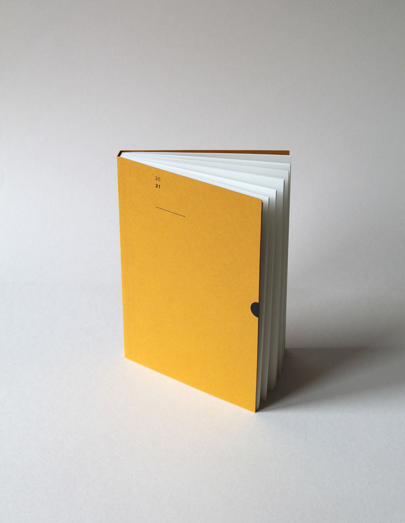 The Mark+Fold 2021 Diary in mustard, featuring our award-winning minimal layout. Mustard card made in Cumbria UK from pulp made of post-consumer waste used coffee cups