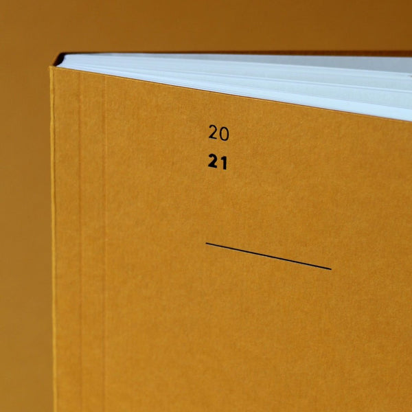 The Mark+Fold 2021 Diary in mustard, featuring our award-winning minimal layout. Mustard card made in Cumbria UK, made with pulp from used coffee cups
