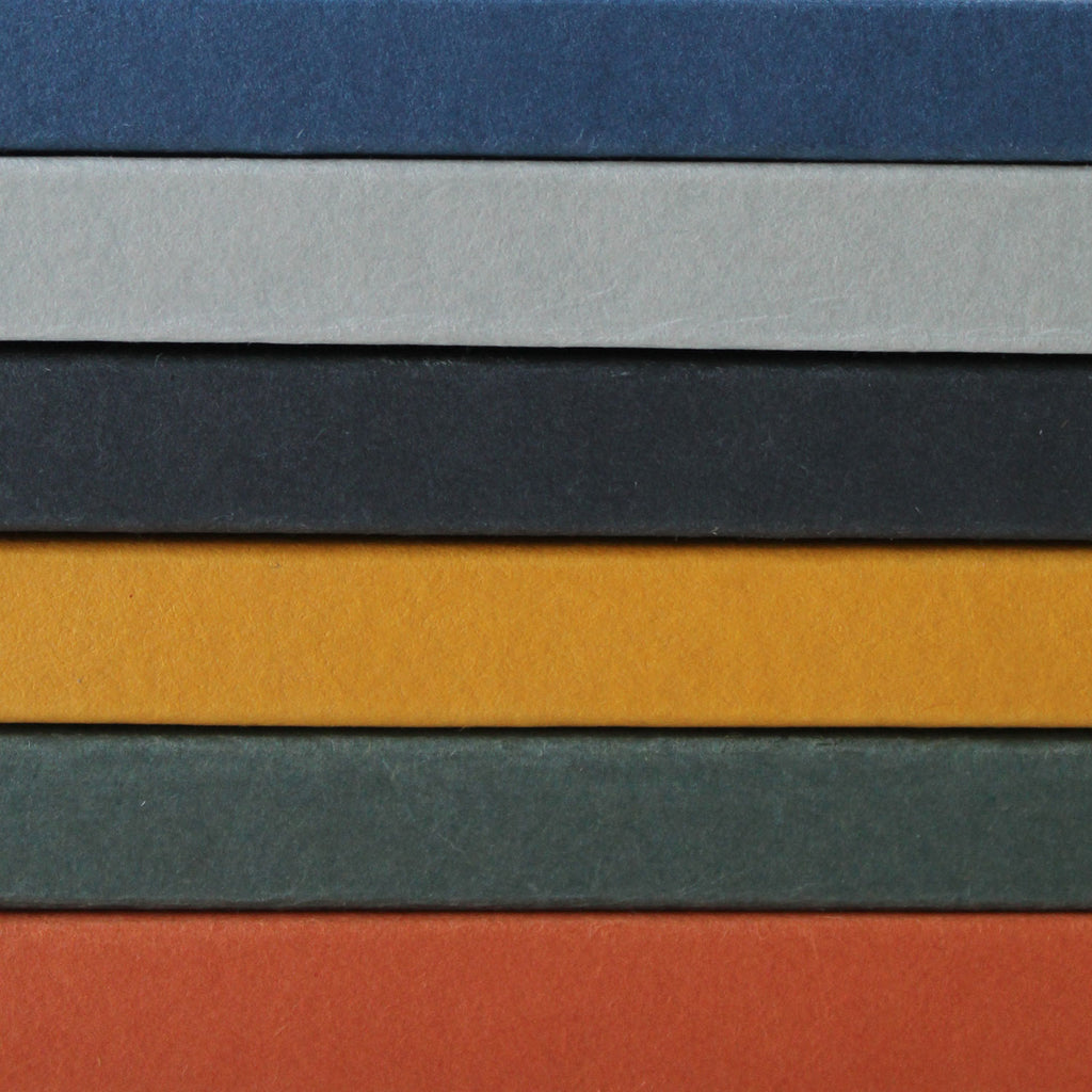 Mark+Fold's 2021 Notebooks, to celebrate the 5th anniversary and bring together the best bits of all our previous batches. Mark+Fold the modern stationer. Colorplan cobalt, Keaykolor Lichen, Extract flint made from used coffee cups, Extract mustard, Keayklolor Sequoia, Colorplan rust. Sustainably made FSC papers.