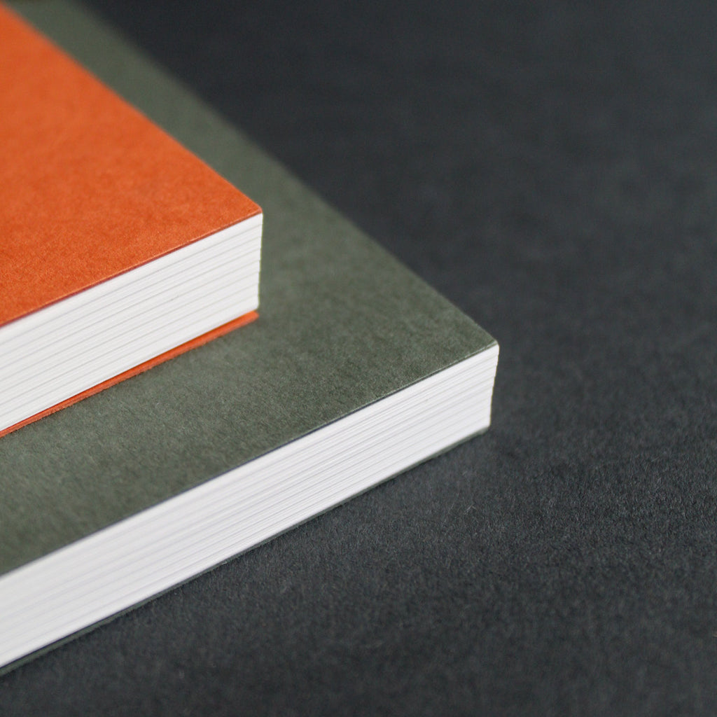 Mark+Fold notebooks in RUst and Sequoia. Layflat notebooks, lined pages