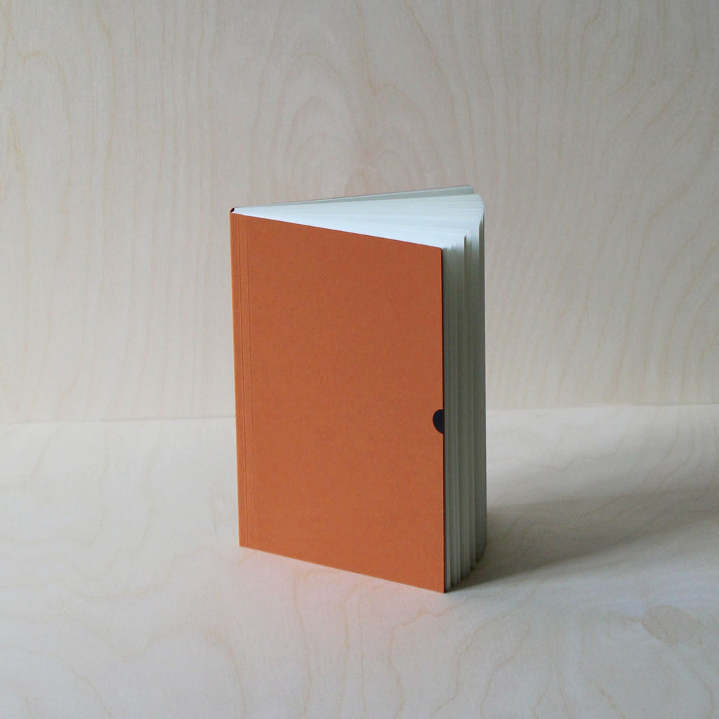 Mark+Fold's Lined notebook in Rust with black foil details. Layflat ota bind notebook. 120gsm smooth cream paper, suitable for fountain pen, made in Scotland. Sustainable transparenyt production. Modern stationery, designed in London.