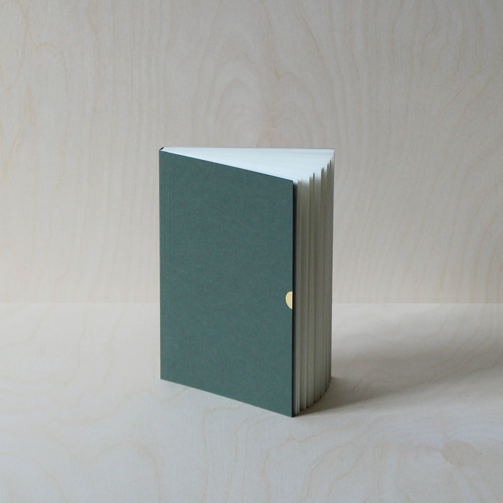 Mark+Fold's Lined notebook in Sequoia with gold details. Layflat ota bind notebook. 120gsm smooth cream paper, suitable for fountain pen, made in Scotland. Sustainable transparenyt production. Modern stationery, designed in London.
