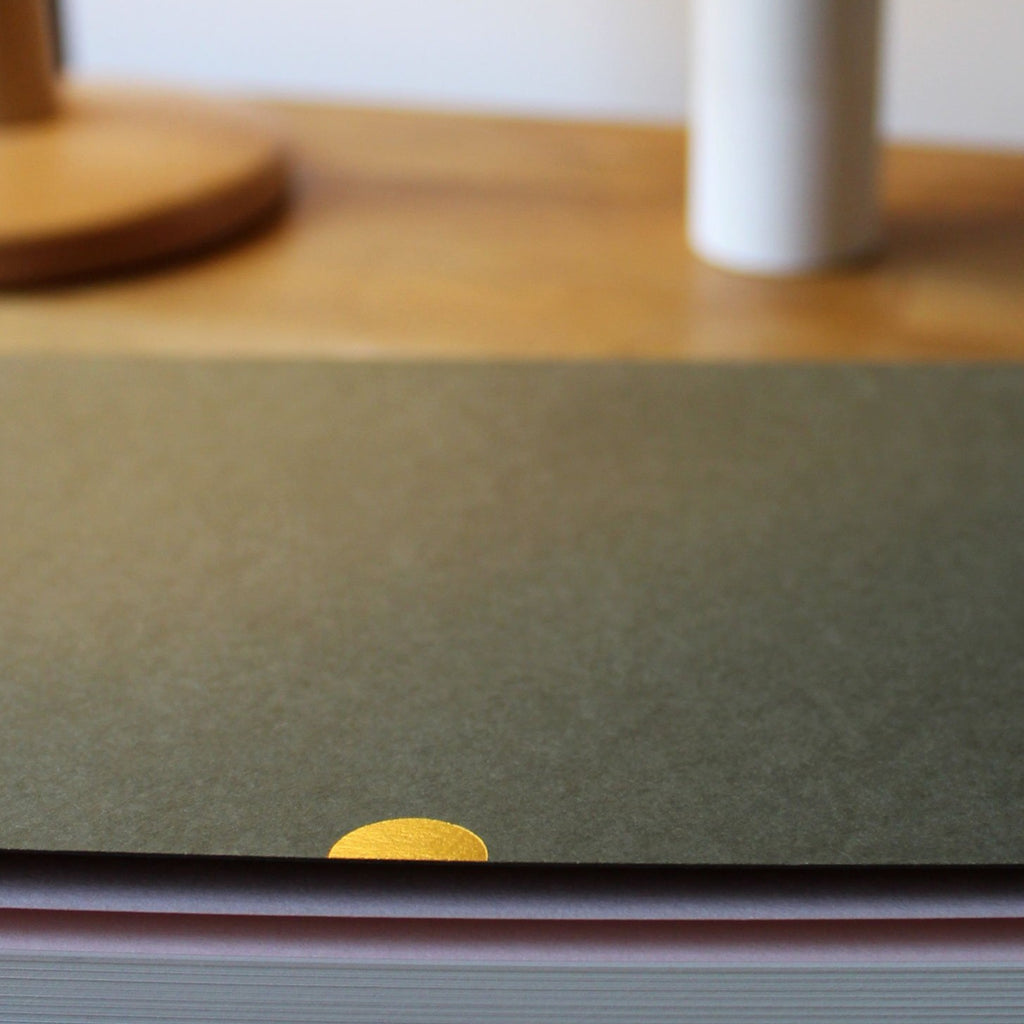 Thumbcut detail in gold. Khaki covers made from used coffee cups (Khaki Extract 380gsm)Another Notebook, a collaboration between Mark+Fold the modern stationer, and British furniture makers Another Country. Featuring Mark+Fold'd beautiful quality details, the notebook is thread-sewn and expertly bound in Belgium for a perfect layflat binding. The cover is made from post-consumer waste