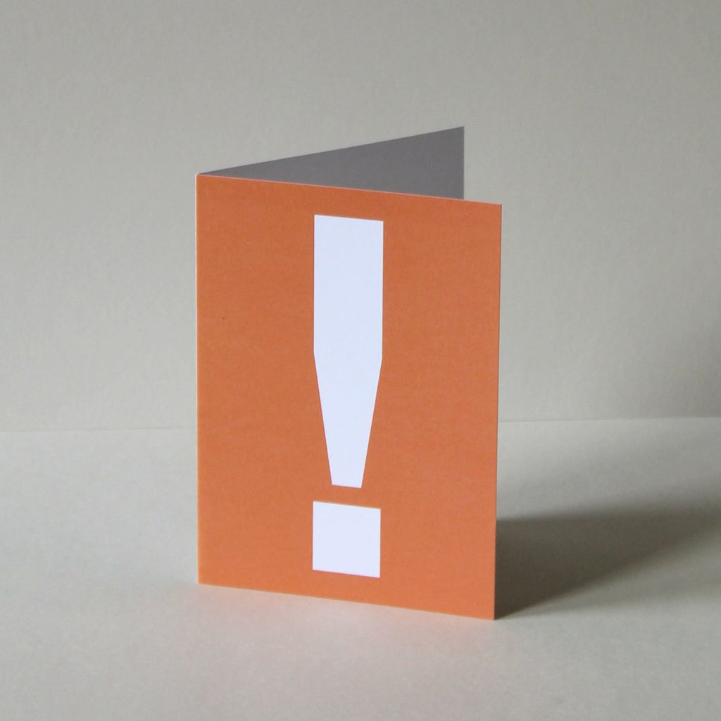 Akzidenz Grotesk. A6 greetings card, printed offset litho in orange ink onto white card. A useful card to have around for when an occasion arises, featuring this most expressive and universal symbol:  the exclamation card says Congratulations! Happy Birthday! I love you! etc.