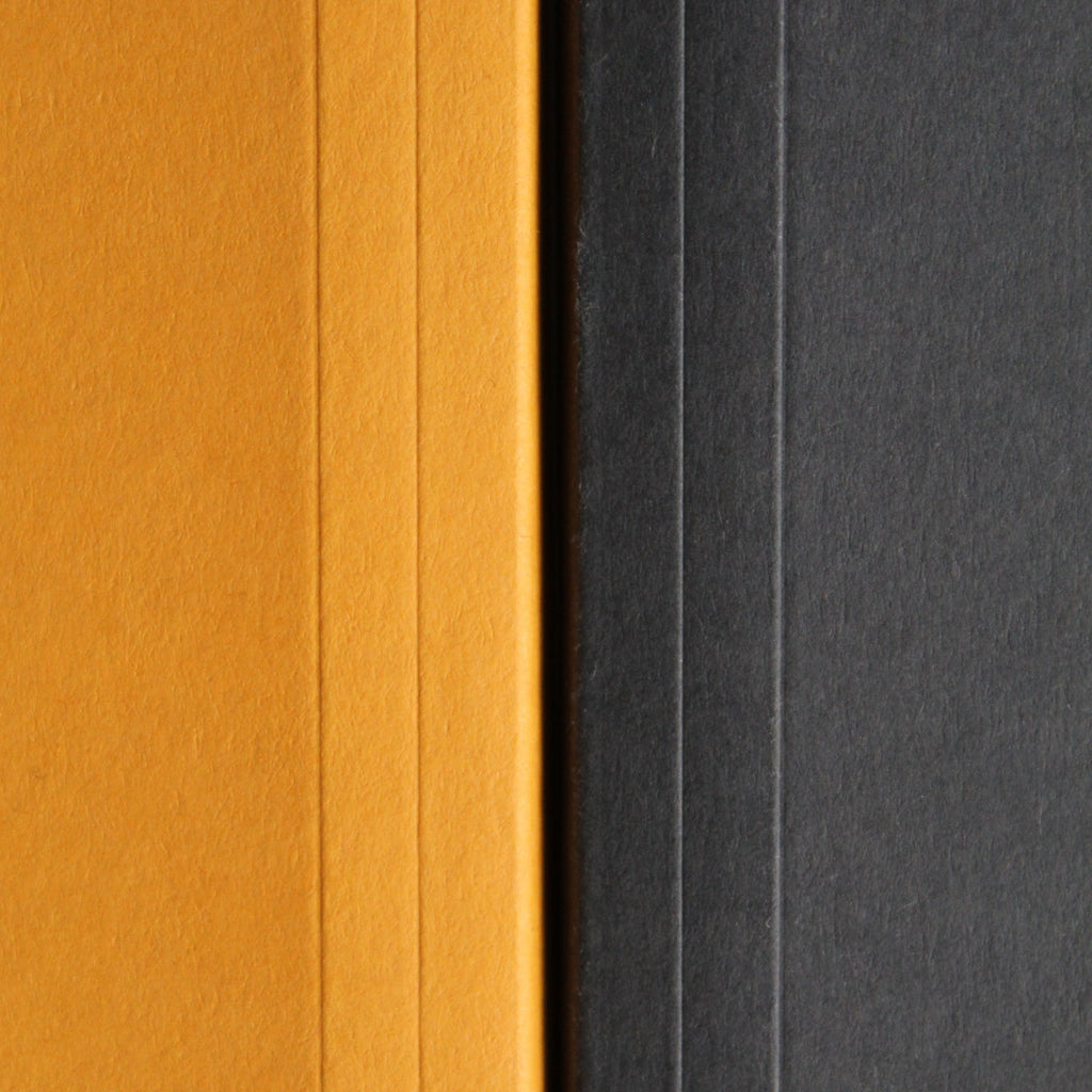 Dot grid notebooks from Mark+Fold the modern stationer, in Flint and mustard.