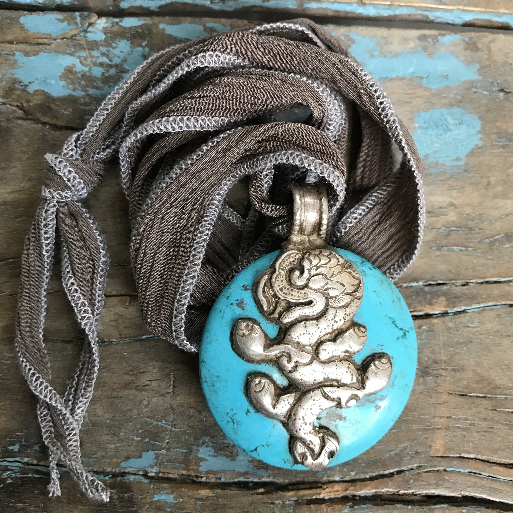Turquoise Medallion with Dragon and Monkey on Taupe Ribbon by Sage Machado - The Sage Lifestyle