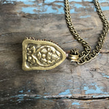 Bone Buddah Medallion on Brass Chain by Sage Machado - The Sage Lifestyle