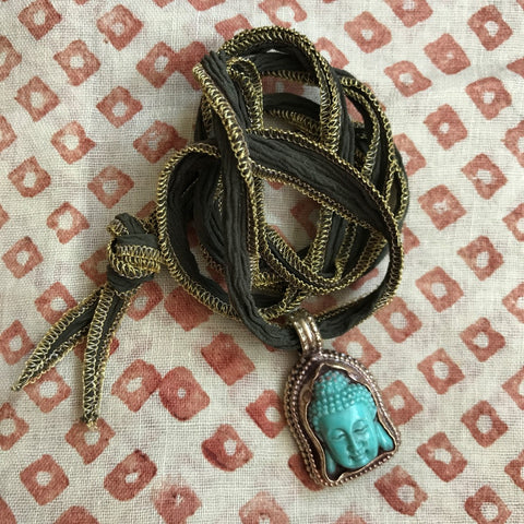 Turquoise Buddah on Army Ribbon by Sage Machado, Buddah Necklace by Sage - The Sage Lifestyle