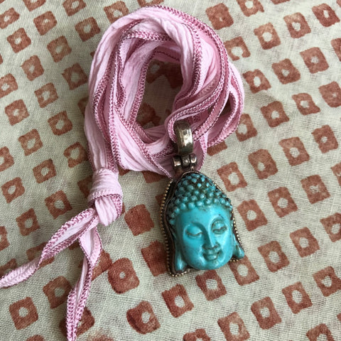 Turquoise Buddah on Ice Pink Ribbon by Sage Machado, Buddah Necklace by Sage - The Sage Lifestyle