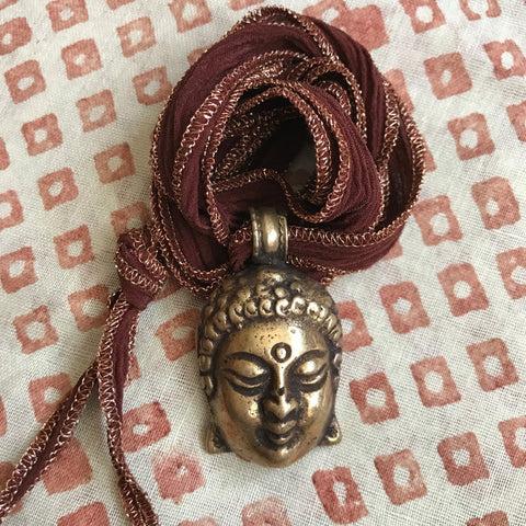 Brass Buddah on Merlot Ribbon by Sage Machado, Buddah Necklace by Sage