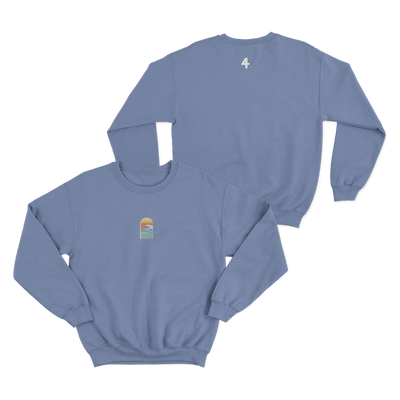 Blue crewneck sweatshirt with a small embroidered logo on the front center showing a sunset and a wave. The back has the number 4 screenprinted just beneath the collar.