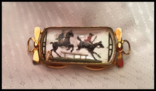 Load image into Gallery viewer, Reverse Crystal Brooch: Antique, hand painted intaglio crystal jumping scene set in 14 kt gold bit style setting