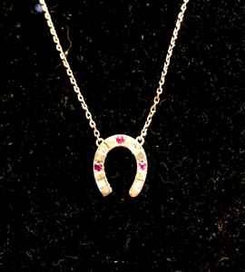 Necklace, 14 kt gold, antique diamond & ruby horse shoe