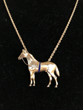 "Load image into Gallery viewer, Necklace, 14 kt gold large horse pendant w a blue surcingle on woven 18"" chain"