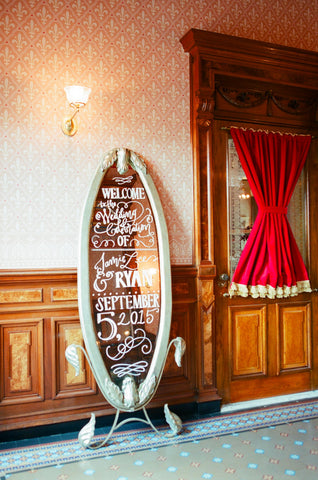 Calligraphy on the rented silver mirror at wedding