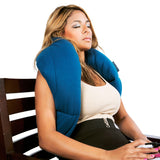 The Sleephug Pillow worn by seated, sleeping female model
