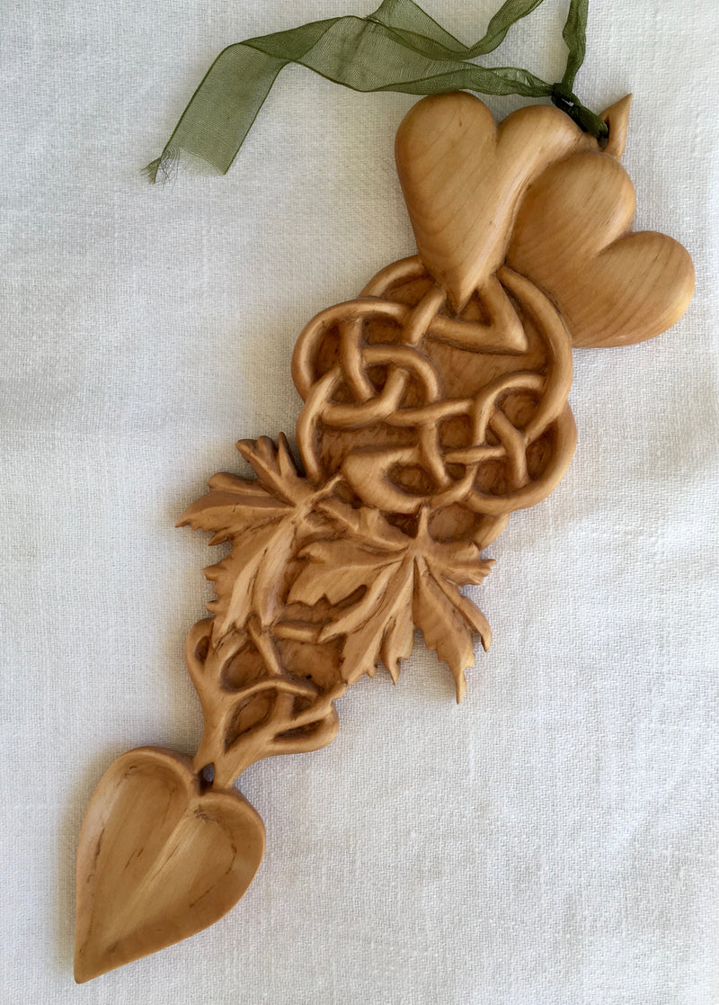 Welsh Love Spoon originated in Wales, where young men would gift hand-carved spoons, cakes and sweets to young women in hopes of winning them over.    Pauline Williams patiently and expertly carves these spoons in fine detail: hearts, infinity rings and maple leafs, an exquisite piece of Can